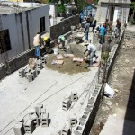 Mixing mortar and laying blocks
