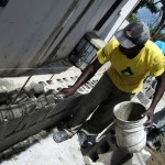 Jean Robert applying mortar